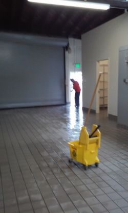Clean America Janitorial janitor in Antelope CA mopping floor.